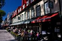 Outside street cafes are what makes up a part of the aura that surrounds the Place d'Armes in Old Quebec in Quebec City, Canada.