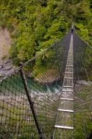 Cross over the Waiohine River on this suspension bridge to Tararua Forest Park on the North Island of New Zealand.