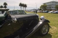 Photo of some sweet classic cars at a collector Car Show in Auckland displaying a restored Rolls Royce vintage car.