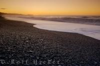 Situated 22 kilometres west of the Fox Glacier townsite, the gravely shores of Gillespies Beach face the Tasman Sea coastline on the West Coast of the South Island of New Zealand.