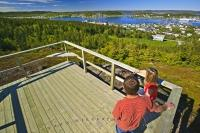 A couple overlook the town of St Anthony from the Tea House Hill platform accessed by a loop trail which starts behind Grenfell House.