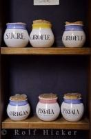 Cute cork topped Terres de Biot pottery jars displayed at a shop in Nice, Provence, France.