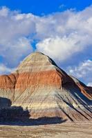 Various layers of materials, some stained by chemical compounds, are clearly seen on the Tepees, a collection of formations in Petrified Forest National Park in Arizona, USA.