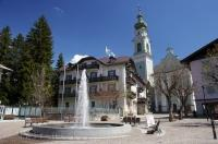 The fountain in the town square of Toblach in South Tyrol, Italy is surrounded by extraordinary buildings.