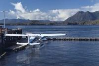 Float planes moored at the Tofino Harbour on the west coast of Vancouver Island in British Columbia, Canada.