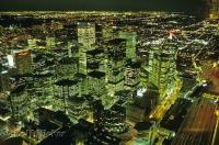 From the CN Tower you can see the entire downtown core of Toronto, Ontario illuminated during the evening with night lights.