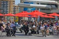 People sit and relax in the street cafe style seating in Yonge-Dundas Square in the downtown area of Toronto, Ontario in Canada.