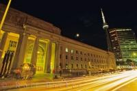 The lights at night in downtown Toronto, Ontario give the impression that the roadways and the train station are made of gold.