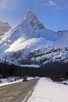 Snowcapped Hilda Peak towers above the Icefields Parkway in Banff National Park, and a Smart Car touring in the Canadian Rockies.