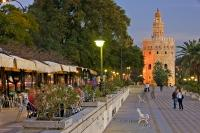 One of the prominent tourist attractions of Seville in Andalusia, Spain is Torre del Oro which houses the Naval Museum and is situated beside the Guadalquivir River.