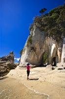 A tourist surveys the scenery at Arch Point (also known as Tonga Arches) in the Abel Tasman National Park in the South Island of New Zealand.