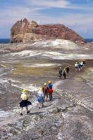 Tourists wander the landscape of White Island which is an active volcano in the Bay of Plenty on the North Island of New Zealand.