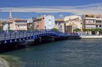 A brilliant blue bridge crosses the Etang de Berre in the town of Martigues along the Cote Bleue in the Provence, France in Europe.