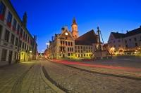 The Town Square, the Marienplatz, of Freising in Bavaria, Germany at dusk shows a variety of interesting lighting effects.