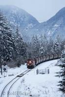 A freight train eases along the tracks during snow fall along side the Fraser River in British Columbia, Canada.
