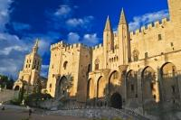 A fascinating travel destination is the ancient walled city of Avignon in the Vaucluse region of Provence, France including its famous tourist attraction Palais des Papes.