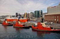 Prepared for work at any given time, red tug boats line the harbour of Wellington on the North Island of New Zealand.