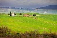 A quaint Tuscan church built in the grassy undulating hills near the town of Pienza, in the scenic Province of Siena in Tuscany, Italy.