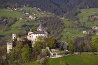 The Tyrolean Castle of Presule guards the plain below the Dolomite mountain Sciliar in the South Tyrol region of Italy.
