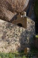 This unique building of ancient architecture located in the shadow of a huge rock, is the Monastery of San Juan de la Pena in the Sierra de la Pena in Aragon, Spain.