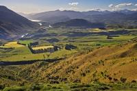 Paddocks and farmland make up the beautiful landscape of the Kawarau River Valley near Queenstown in Central Otago on the South Island of New Zealand.