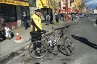 A Vancouver Police Officer poses beside his bike in Chinatown in Vancouver, British Columbia in Canada.