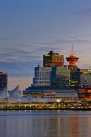 The Vancouver skyline may not be as recognizable as some other skylines in the world, but it is beautiful, especially when it is lit up at night, such as in this picture. Vancouver has become more internationally known after hosting the Olympics.