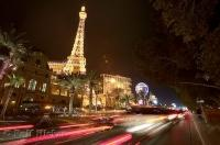 The Eiffel Tower of the Paris Hotel in Las Vegas lights up The Strip in Las Vegas, Nevada.