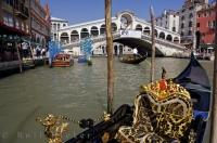 The Venetian bridge Ponte di Rialto as seen from a Gondola on the Grand Canal in Venice, Veneto in Italy.
