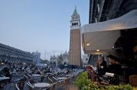 Seats fill the area of the Caffe Florian in the Piazzo San Marco in Venice as musicians play for the people that want a real taste of Italy.