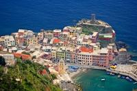 The Cinque Terre in Liguria, Italy is a very extraordinary travel destination, especially the village of Vernazza as seen in this aerial shot.