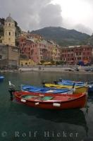 Colorful boats line the harbor of Vernazza in Liguria, Italy in Europe.