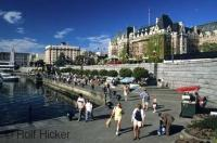 A popular summer time activity is a walk along the waterfront in the pretty city of Victoria in BC with the Fairmont Empress Hotel in the background.