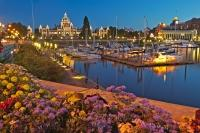 Family Vaction City Victoria in British Columbia. Surrounded by Hotels, the harbour is a part of Victorias Secret which is beauifully lit at night, Vancouver Island.
