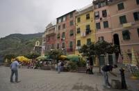 Even on a cloudy day in the village of Vernazza, Liguria in Italy, people still love to spend time at a waterfront cafe and take in the beauty of this ideal vacation spot.