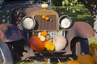 In Keremeos, British Columbia, a vintage car, pumpkins and squash grace an autumn display at a farmers' market stall along Highway 3.