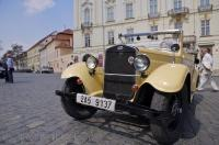 A vintage car stops for some sightseeing in Prague in the Czech Republic in Europe.