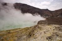 Crater Lake on White Island in New Zealand can hardly be seen due to the amount of steam rising off the volcanic lake.