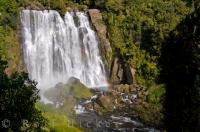 The Marokopa Falls in Waikato on the North Island of New Zealand cascade over the rocky ledges.