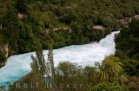 An overhead look at the fascinating Waikato River where the Huka Falls on the North Island of New Zealand thunder over volcanic cliffs.