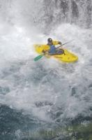 A kayaker sitting upright after descending the Sauth deth Pish waterfall while taking part in the water sport of waterfall running.