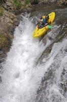 Running a waterfall in a kayak is one of the popular water sports.
