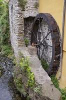 An old water wheel seen along the road to Vernazza in the Liquria, Italy.