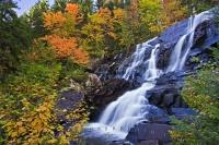 Beautiful Chutes aux Rats waterfall surrounded by fall colors in Parc national du Mont Tremblant in the Canadian province of Quebec.
