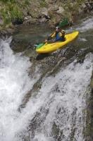 A man engaged in one of the popular watersports in the Pyrenees.