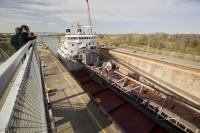 A large ship eases into position in the Welland Canals Lock 3 situated in St Catharines, Ontario, Canada.
