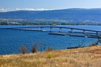 This floating bridge located in Kelowna, a city in the Okanagan in BC, Canada, is known as the William R. Bennett Bridge. It opened in May 2008, and this bridge replaced the three lane Kelowna Floating Bridge which could no longer handle all the traffic.