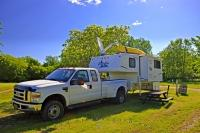 The Conestoga Campground in the city of Winnipeg is situated in a beautiful park like setting which gives the feeling of being miles away from the city.