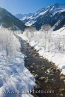 The winter scenery in the valley Wildgerlostal in Salzburger Land in Austria, Europe is picturesque with the river flowing between the snowy banks.