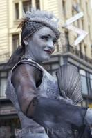 A woman busker performs in Graben Square in downtown Vienna in Austria, Europe.
